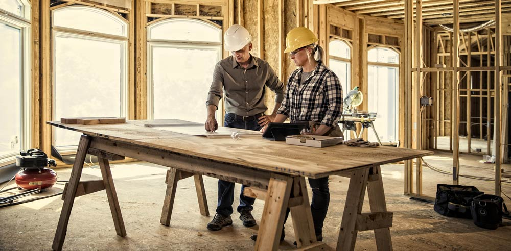 Contractors discussing plans