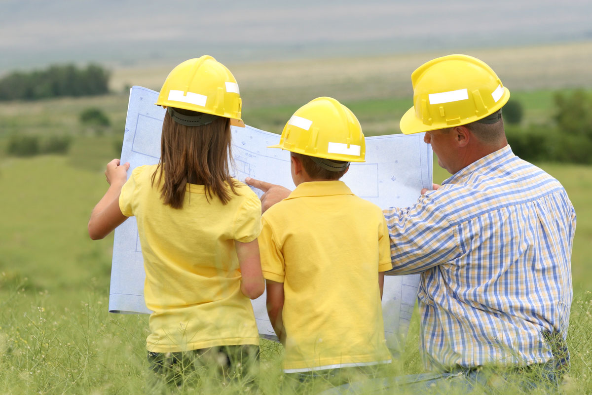 Family-looking-at-blueprints