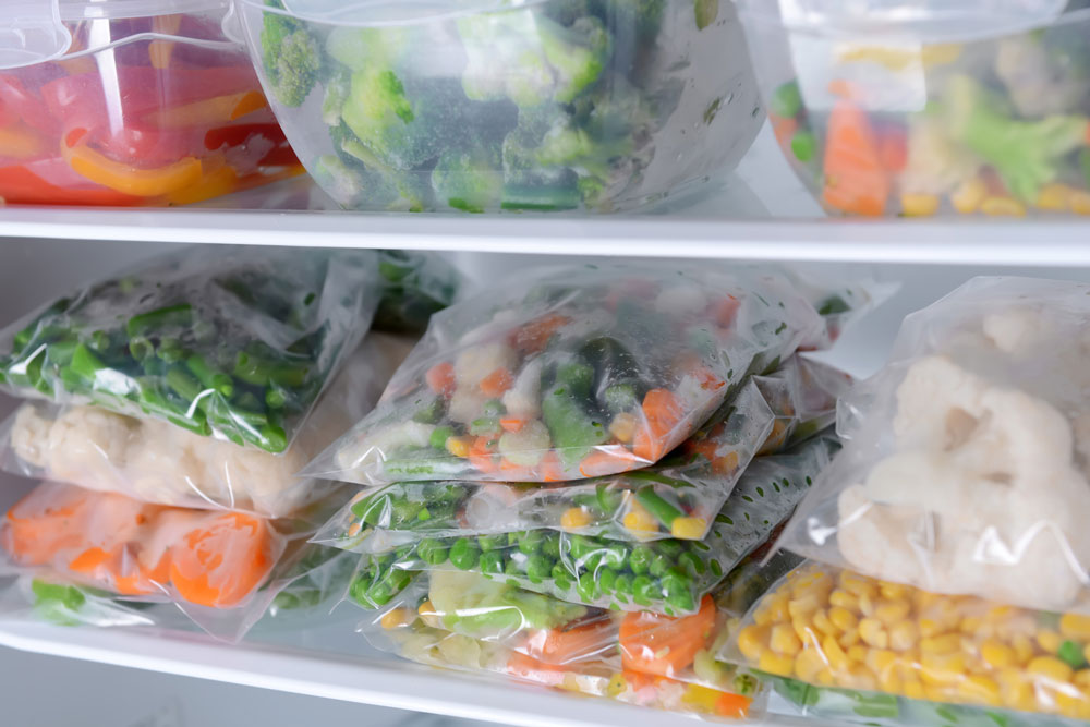 Photo of cooken vegetables in freezer bag in freexer