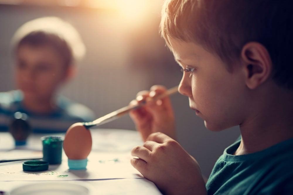 Kids painting eggs