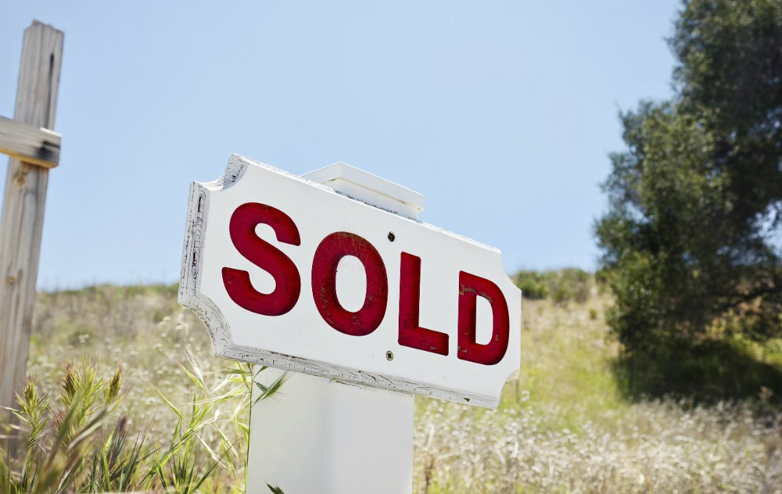 Land_with_Sold_Sign.jpg
