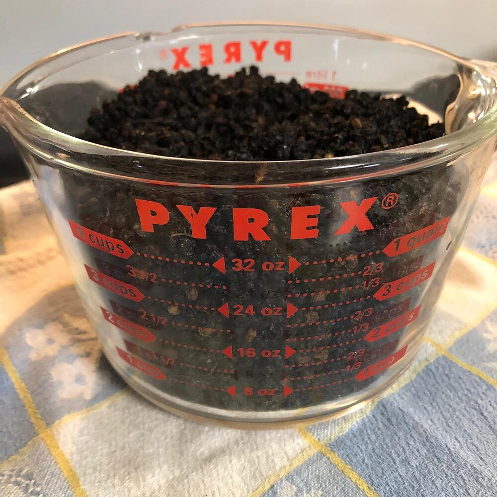 Elderberries in measuring cup