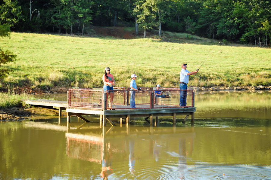 Outz family fishing in their stocked pond
