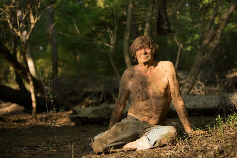 VALDOSTA, GA.- Colbert sitting on the ground, caked in mud