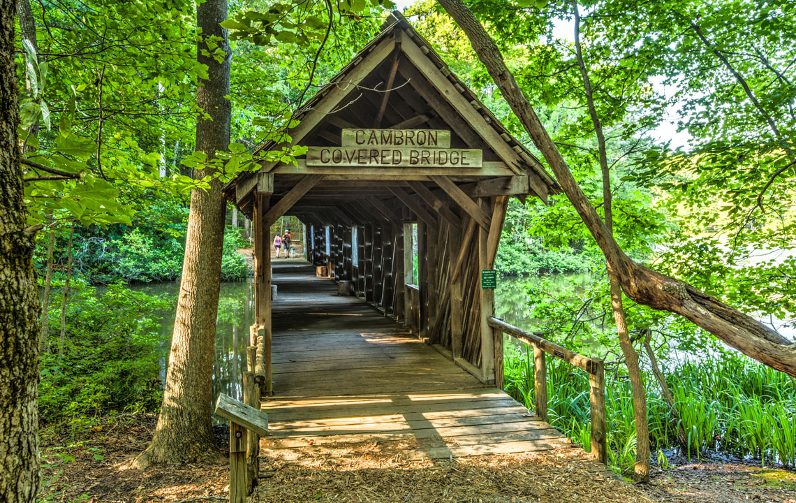 Take a beautiful photo tour of the Cambron Covered Bridge in Huntsville, Alabama, and learn the history behind it.