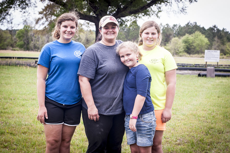 Farm girls: Eddie Conner's daughter and granddaughters help out with chores at Conner's A-Maize-Ing Acres