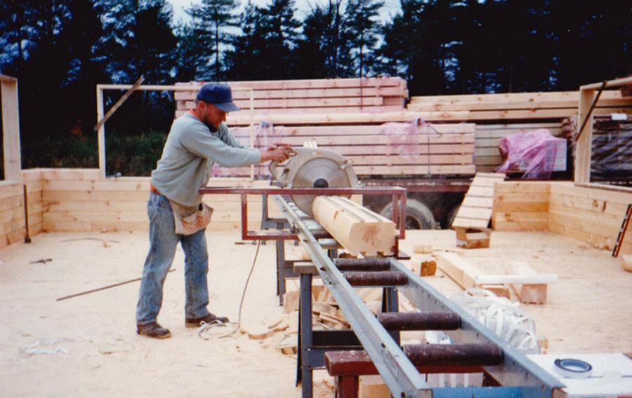Building a log house with uncut logs