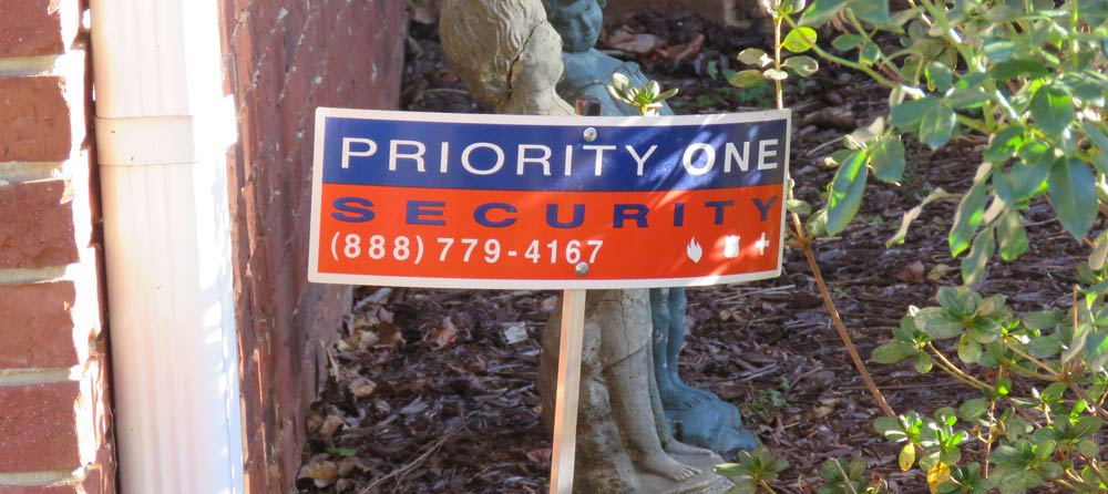 Priority One security sign in ground